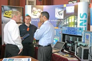 Delegates quiz exhibitors at the PROFIBUS Conference